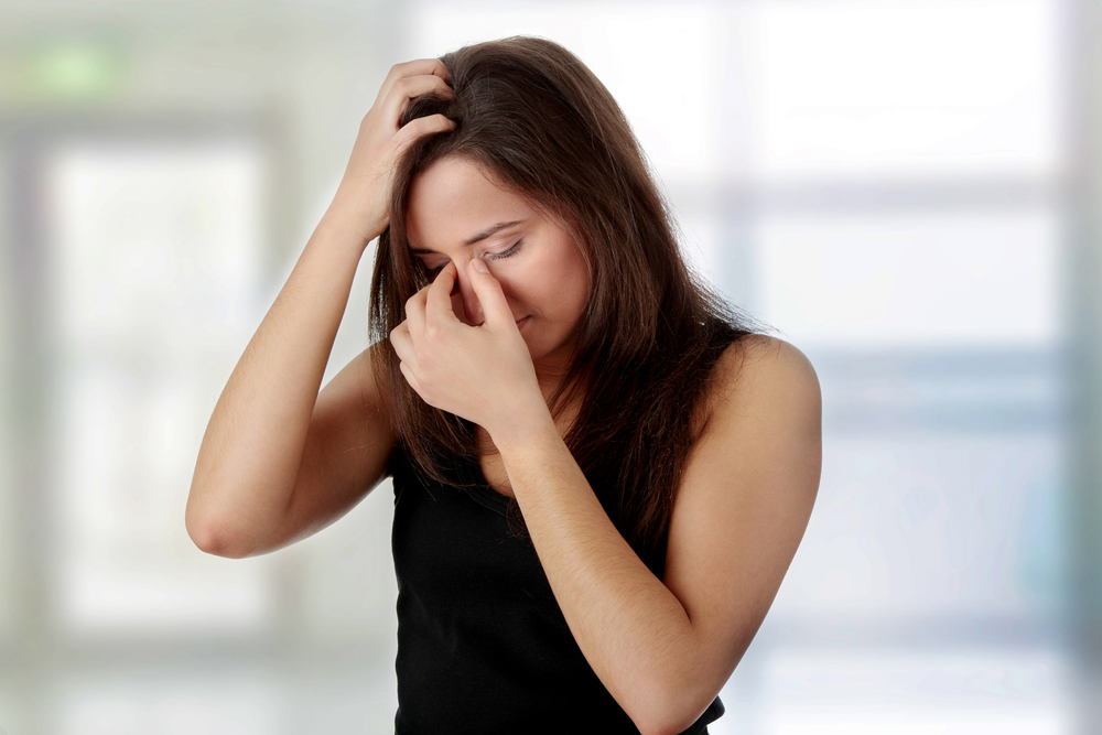 Woman suffering from a sinus headache