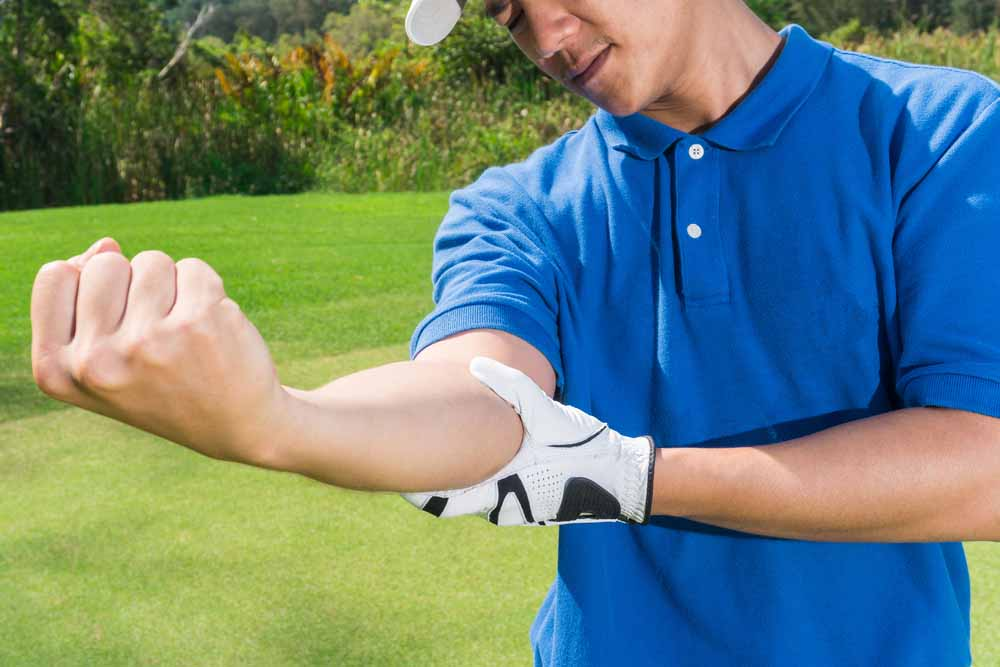 Man suffering from Golfers Elbow